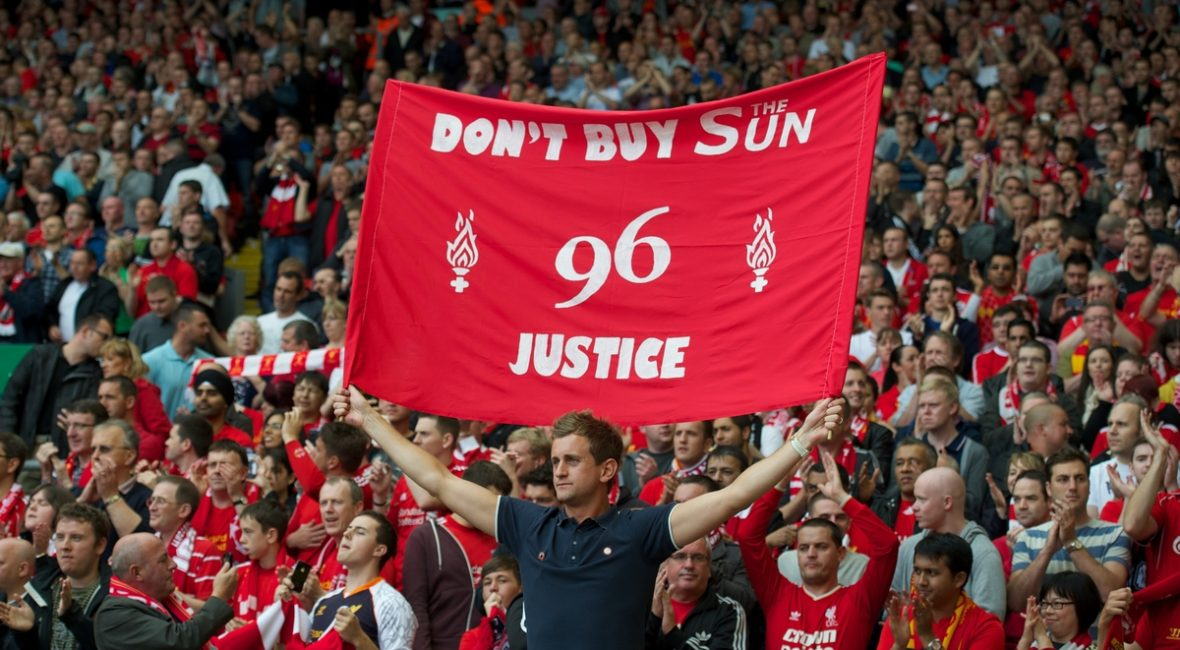 LIVERPOOL, ENGLAND - Sunday September 2, 2012: A Liverpool supporter with a banner 'Don't Buy The Sun - 96 Justice' during the Premiership match against Arsenal at Anfield. (Pic by David Rawcliffe/Propaganda)